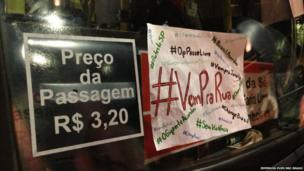 Placards stuck to a bus window in Sao Paulo, 17 June 2013