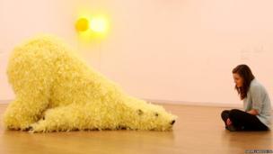 Elizabeth Evans looks at a sculpture of a polar bear