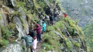 In this photograph received from the Defence Ministry on June 19, 2013 members of the Indian Defence Forces rescue stranded villagers in the northern Uttarakhand state.