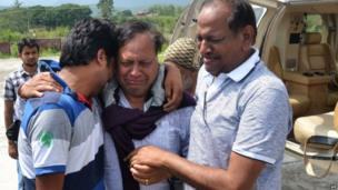 Indian pilgrims that were evacuated from a flood hit area by helicopter hug family members after arriving in Dehradun, the capital of the state of Uttarakhand on July 19, 2013.