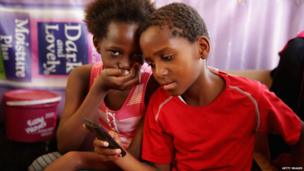 Children at a hairdressers in Diepsloot in South Africa - Monday 17 June 2013