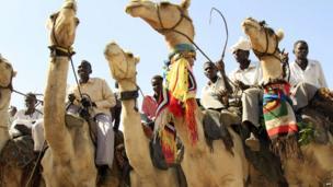 Men on camels in Darfur, Sudan - Tuesday 18 June 2013