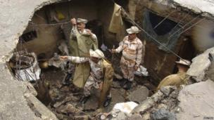 Indo-Tibetan Border Police (ITBP) personnel search for flood victims in a damaged house in Uttarkashi, Uttarakhand