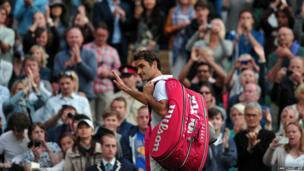 Switzerland's Roger Federer walks off centre court