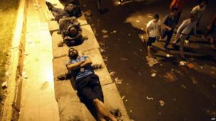 Egyptian opposition demonstrators calling for the ouster of President Mohamed Morsi sleep outside the presidential palace in Cairo early on July 1, 2013.