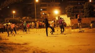 Egyptian protesters attack the Muslim Brotherhood headquarters in the Muqattam district in Cairo, Sunday, June 30, 2013