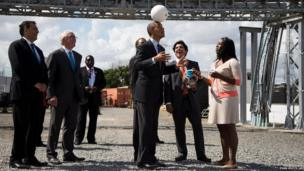 US President Barack Obama demonstrates the Soccket Ball