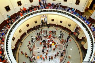 Protesters line the floors of the rotunda at the State Capitol building during a protest before the start of a special session of the Legislature in Austin, Texas