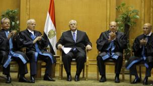 Constitutional court judges applaud Adly Mansour after his inauguration in Cairo, 4 July