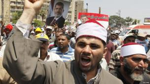 Morsi supporters rally at Cairo's Raba El-Adwyia Mosque, 4 July