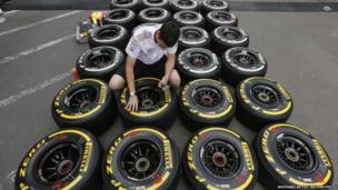 An engineer checks the new Kevlar-enforced rear tyres of McLaren Formula One drivers Sergio Perez of Mexico and Jenson Button of Britain before the German F1 Grand Prix on Sunday, at the Nuerburgring racing circuit, 4 July 2013