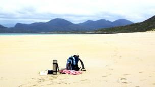 Rucksack on a deserted beach