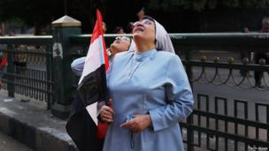 Nuns looking up at the sky near Tahrir Square (4 July 2013)
