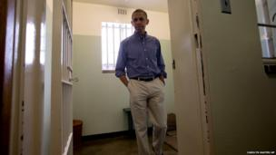 US President Barack Obama walks from Section B, prison cell on Robben Island, South Africa