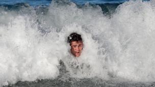 Australia's rugby captain James Horwill bodysurfs