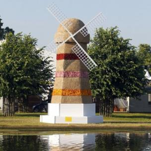 The Escape Windmill by Shipshape Arts on display at the RHS Hampton Court Palace Flower Show