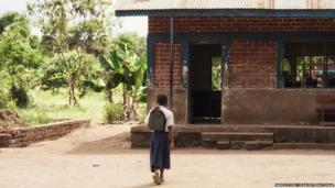 Tanzanian schoolgirl Sylvia arriving at her school