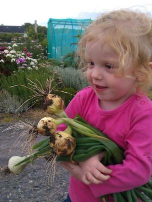 Girl carrying spring onions