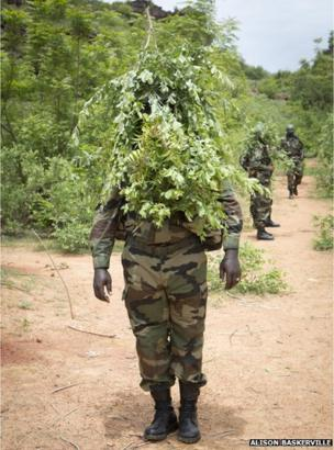 A Malian soldier puts his camouflage lesson to use