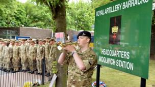 Bugler Dan Griffith plays the last post outside the main gate to Woolwich Barracks in south east London, in memory of Fusilier Lee Rigby, as his funeral takes place