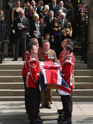 The family of Fusilier Lee Rigby follow his coffin as it leaves Bury Parish Church after his military funeral