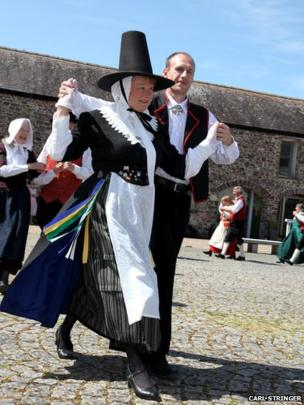 Woman in Welsh dress dancing