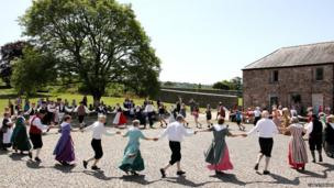 dancers in large circle