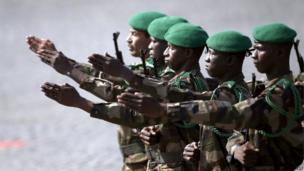 Malian troops march
