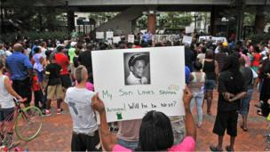 Woman holding a sign in support of Trayvon Martin in Jacksonville, Florida (14 July)