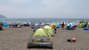 A man sunbathing at Shonan beach