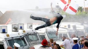 Protestor falling from roof