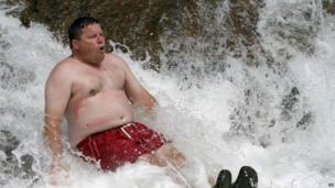 Man keeps cool while swimming in the water at the Lower Falls of the Swift River in Albany, New Hampshire, on 16 July 2013