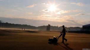 Groundsman with lawn mower at Muirfield Golf Club