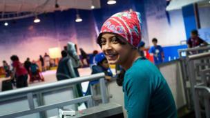 Sarah, student, smiling in spectator area