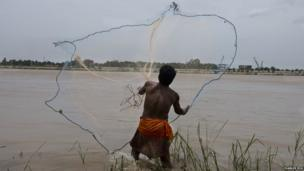 Man throws a fishing net
