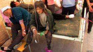 Injured people get treatment in a hospital after an earthquake hit Minxian county in China's north-west Gansu province on 22 July, 2013.