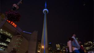 CN Tower in Toronto lit up in blue