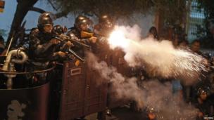 Riot police fire rubber bullets at demonstrators