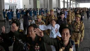 North Korean veterans of the Korean War arrive at the Pyongyang, North Korea railway station Tuesday, July 23, 2013 as the country prepares to mark the 60th anniversary of the end of the Korean War