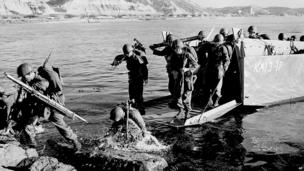 Soldiers of the First US Cavalry Division land ashore at Pohang on the east coast of Korea during the Korean War. July 1950