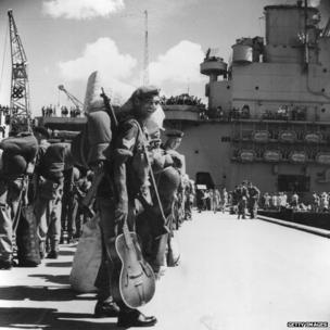 Men of the 1st Battalion of the Middlesex Regiment at Holts Wharf, Kowloon, Hong Kong wait to board HMS Unicorn. They are being sent to fight in the Korean War. August 1950.