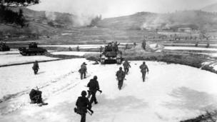 US First Cavalry Division infantrymen, supported by the 24th Division tanks, move out for an assault on an enemy-held hill in South Korea 18 February 1951