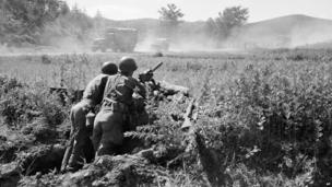 Machine gunner near United Nations advance truce camp in Korea