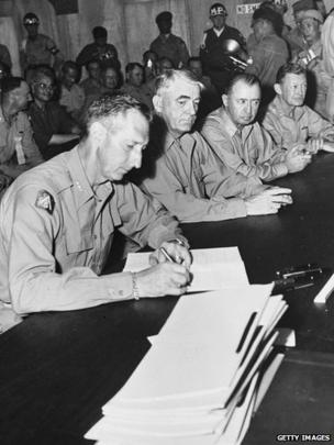 American Lieutenant General Mark Clark (1896 - 1984) signing the Korean Armistice at Munsan, South Korea, 27 July 1953