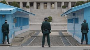 South Korean soldiers stand guard at the border village of Panmunjom between South and North Korea at the Demilitarized Zone (DMZ) on 23 April 2013 in Panmunjom, South Korea