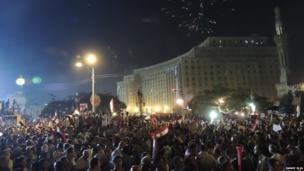 Fireworks go off above crowds in Tahrir Square, Cairo, Egypt. Photo: Ramez Elia