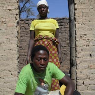 Chipo Matemo and her husband Daniel Bhobho, a Zanu-PF supporter, in their hut which was set ablaze in Mashonaland West