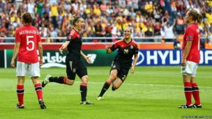 Anja Mittag of Germany celebrates