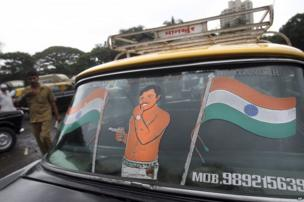 Indian flag is painted on the back windshield of a Mumbai Premier Padmini taxi, in Mumbai, India