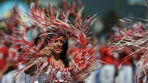 A team of student dancers takes part in El Correo on 1 August 2013 in San Salvador